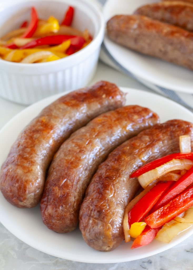 Sausages on a plate with peppers