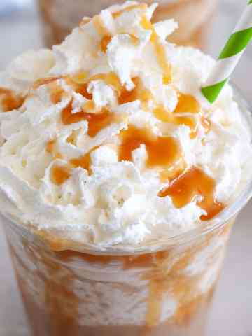 Glass of caramel frappuccino with whipped cream