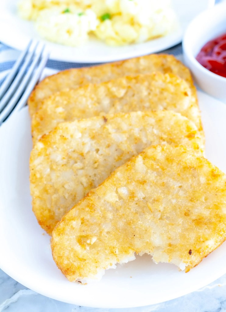 hash browns with a bite taken out
