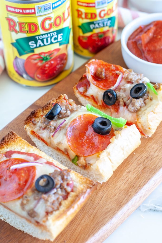 Sliced French bread pizza on board