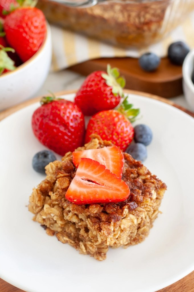 Square of baked oatmeal with strawberries and blueberries.