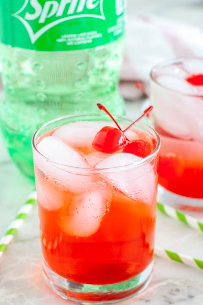 Glass with soda and grenadine.