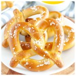 Soft pretzels on plate.