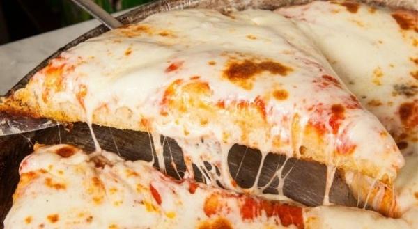 Spontini sceglie in esclusiva Glovo per portare l'iconica pizza al trancio nelle case meneghine