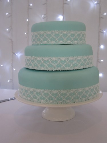 Turquoise Wedding Cake with Lace Ribbon