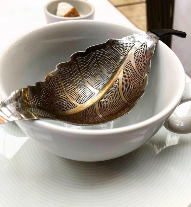 Leaf Shape Tea Strainer Balanced on An Empty Tea Cup at Dominique Ansel Bakery Afternoon Tea, London