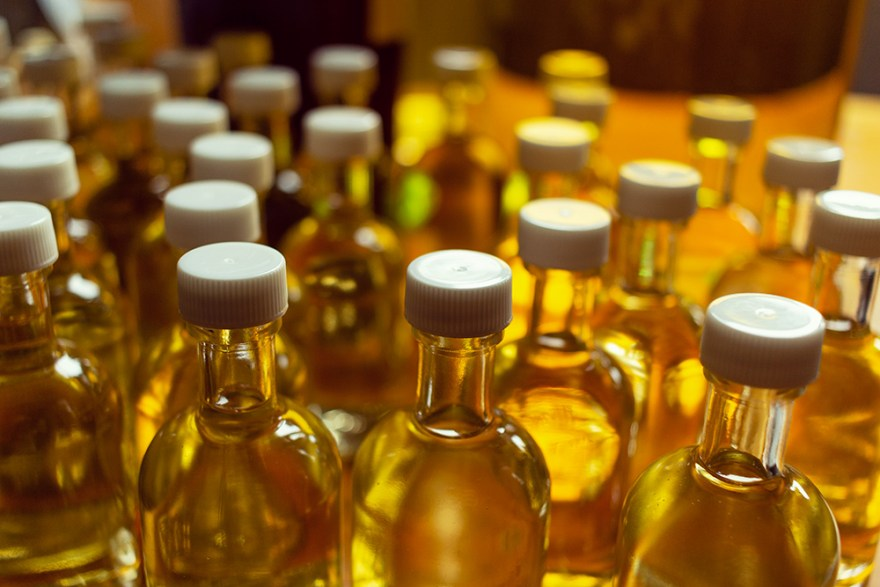 golden bottles of whisky at Red River Distillery in Scotland
