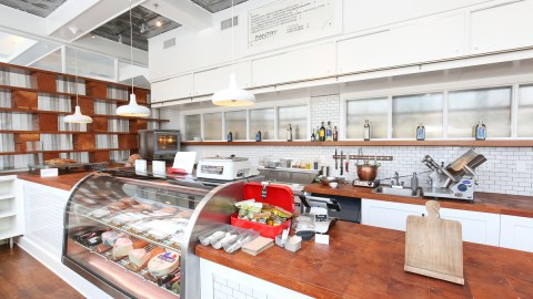 Among the design highlights at Sarto's is the Pantry, a small market that doubles as an extra bar when the main dining room is busy. All photos (more below) by Adam Larkey Photography.