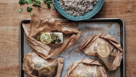 Baking halibut in parchment paper pockets yields tender, moist and flavorful results, with minimal cleanup.