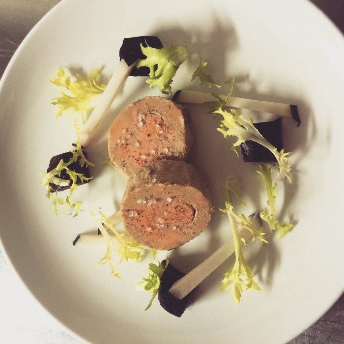 Neo-French classics can be found on the menu at Le Garage, including this foie gras torchon.