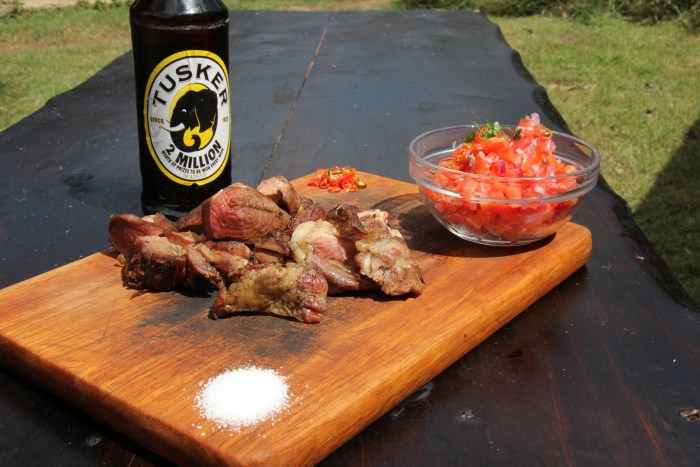 Nyama choma, while delicious, is also an excuse to gather round the open fire and chat while the meats are grilled.