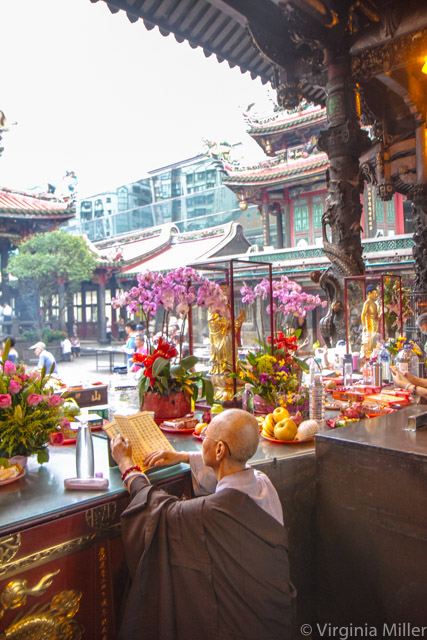 Monk at Lungshan Temple-Copyright Virginia Miller