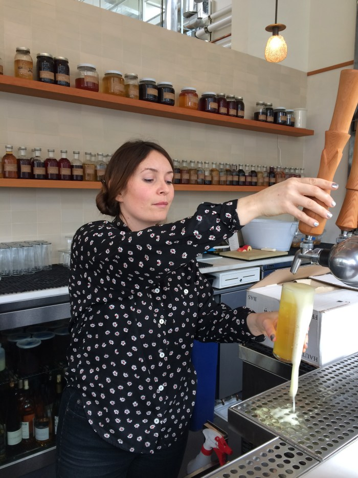 Suzanne pulls a glass of kefir fresh on tap at San Francisco's Tartine Manufactory. (Photo: Mary Ladd.)