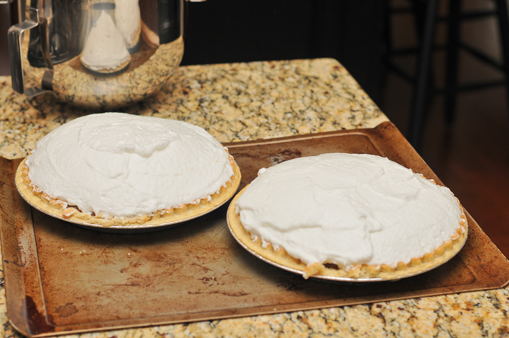 meringue spread evenly on chocolate pies
