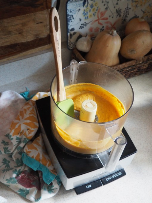 food processor with pumpkin sugar eggs and oil