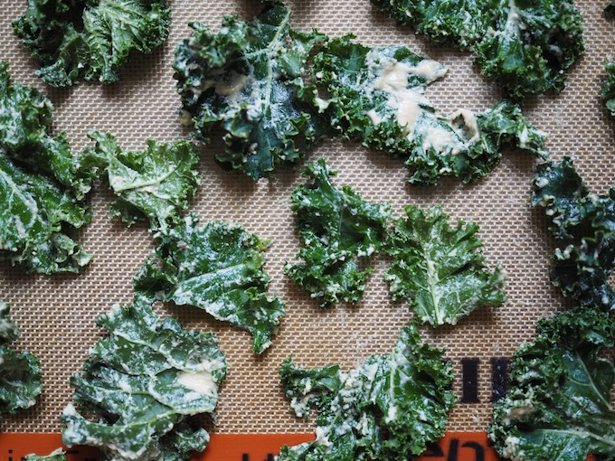 kale chips laid on baking sheet