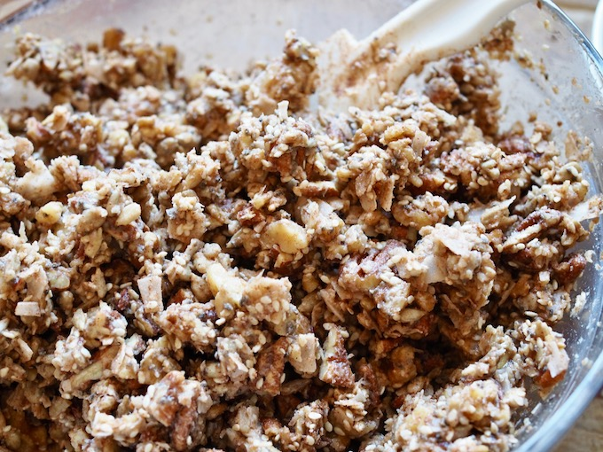 bowl of nuts, seeds, and coconut mixed with applesauce mixture