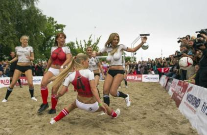 Porn actresses posing as German and Danish teams play soccer during Sexy Soccer game in Berlin