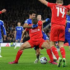 Costa doing something to Liverpool Captain Gerrard in their League Cup Clash