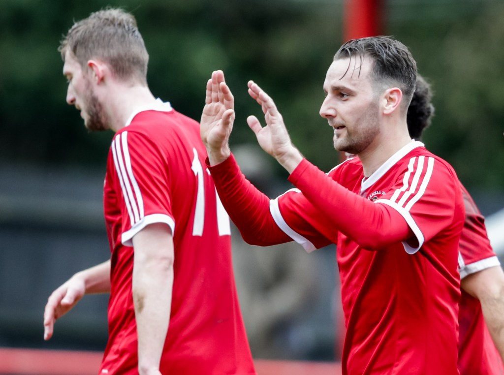 Adam Cornell celebrates scoring for Bracknell Town against Brimscombe & Thrupp. Photo: Neil Graham.
