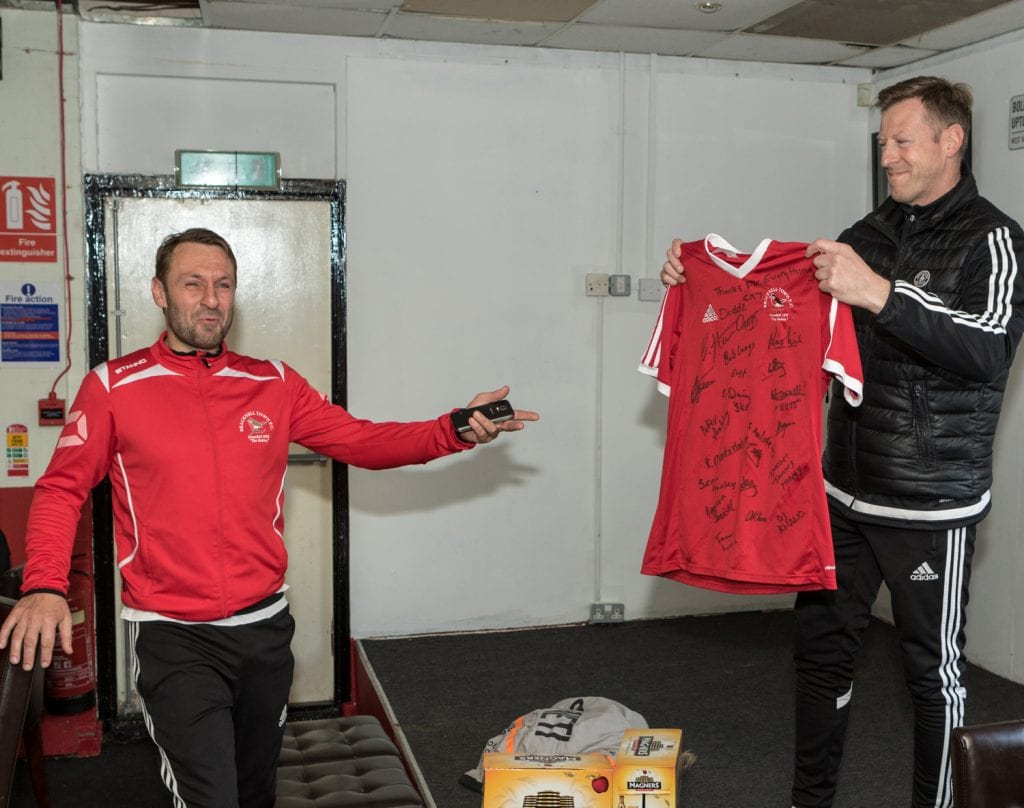 Mark Tallentire presents a signed shirt to Steve Nebbett. Photo: Neil Graham.