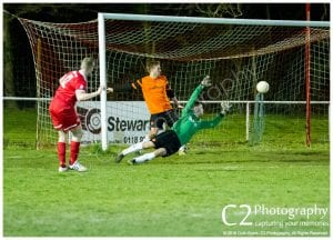 Jean-Claude Etienne scores for Binfield against Wokingham & Emmbrook in the Reading Senior Cup. Photo: Colin Byers.
