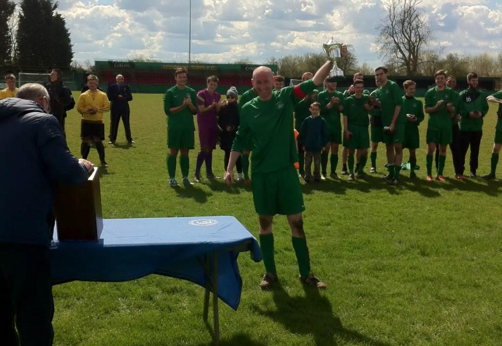 Whitegrove captain Lee Kilmartin lifts the Berks & Bucks County Cup. Photo: Darrell Freeland.