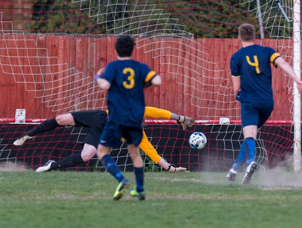 Binfield Club Athletic captain Tom Williams scores from the penalty spot. Photo: Neil Graham.