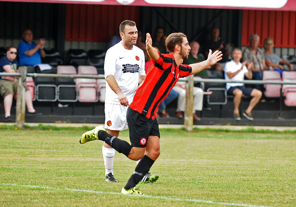 Conor Harlowe celebrates scoring for Sandhurst Town FC. Photo: Mark Pugh.