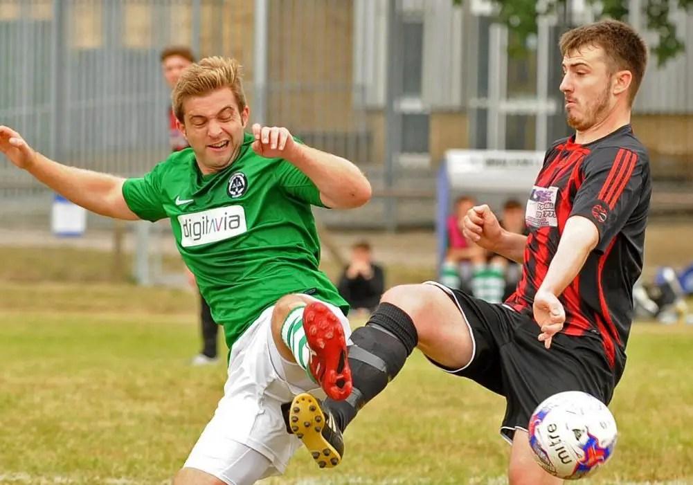 Sam Dennison challenges for Berks County FC. Photo: Mark Pugh.