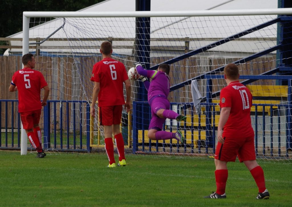 Liam Vaughan makes a save for Binfield FC. Photo: James Green.
