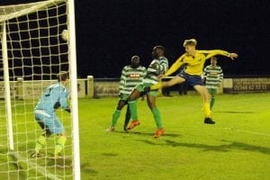 Louis Gilpin heads wide against Thame United. Photo: Mark Pugh.