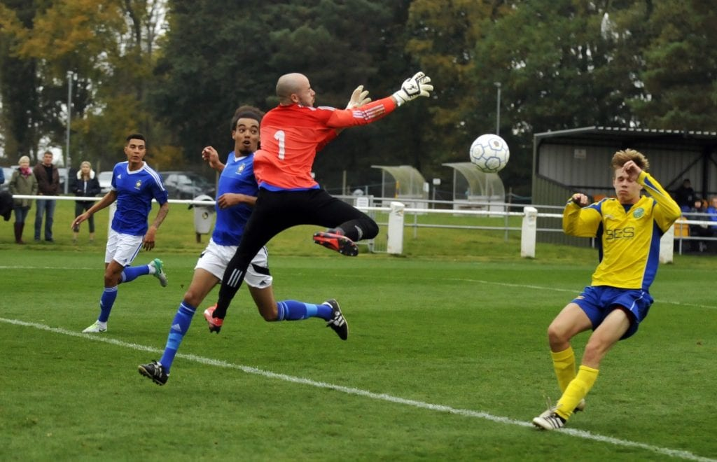 Sean Saxty clears the ball for Highmoor-IBIS. Photo: Mark Pugh.