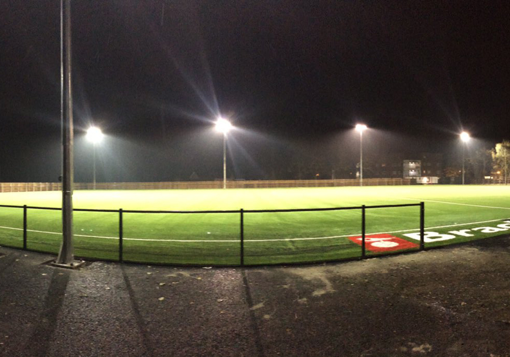 The floodlights are on at Bracknell Town's Larges Lane ground. Photo: Kayne Steinborn-Busse.
