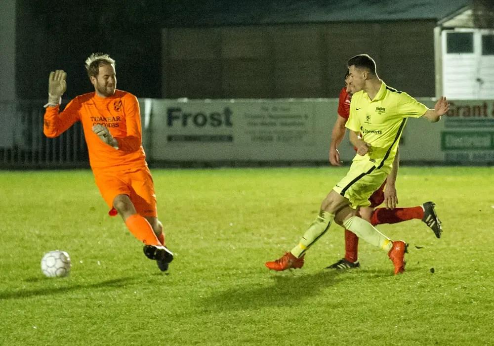 Luke Hayden scores for Binfield FC against Flackwell Heath. Photo: Colin Byers.
