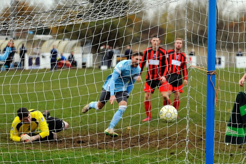 Charlie Oakley scores for Woodley United. Photo: Mark Pugh.