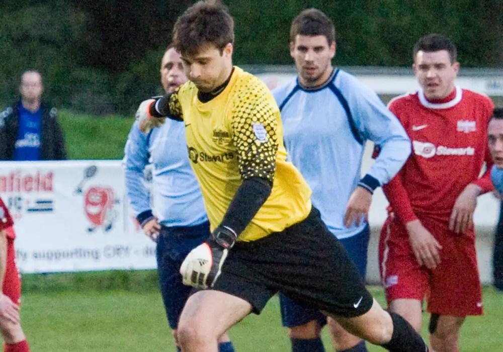 Dan Weait taking a penalty for Binfield. Photo: Colin Byers.