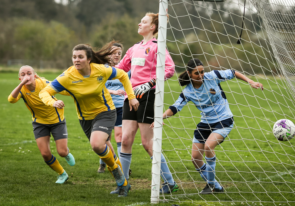 Rosie Page Smith scores for Woodley United Ladies. Photo: Neil Graham.