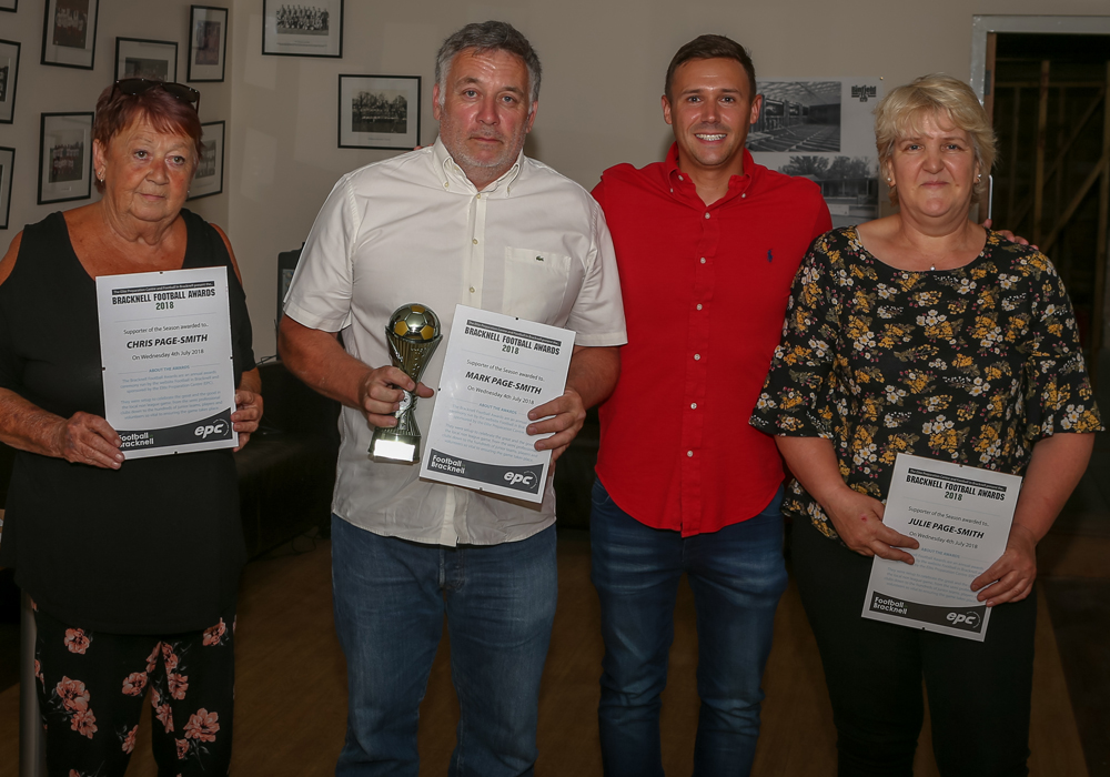 Mark, Chris and Julie Page-Smith accept their award for Supporters of the Season. Photo: Neil Graham