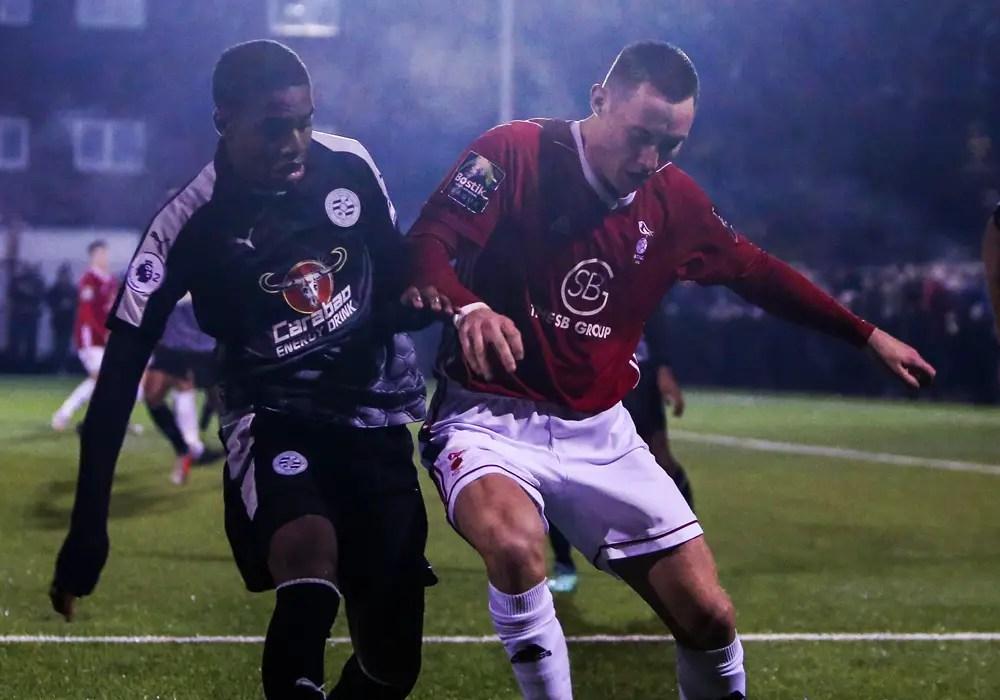 Joe Grant playing for Bracknell Town against Reading FC. Photo: Neil Graham.