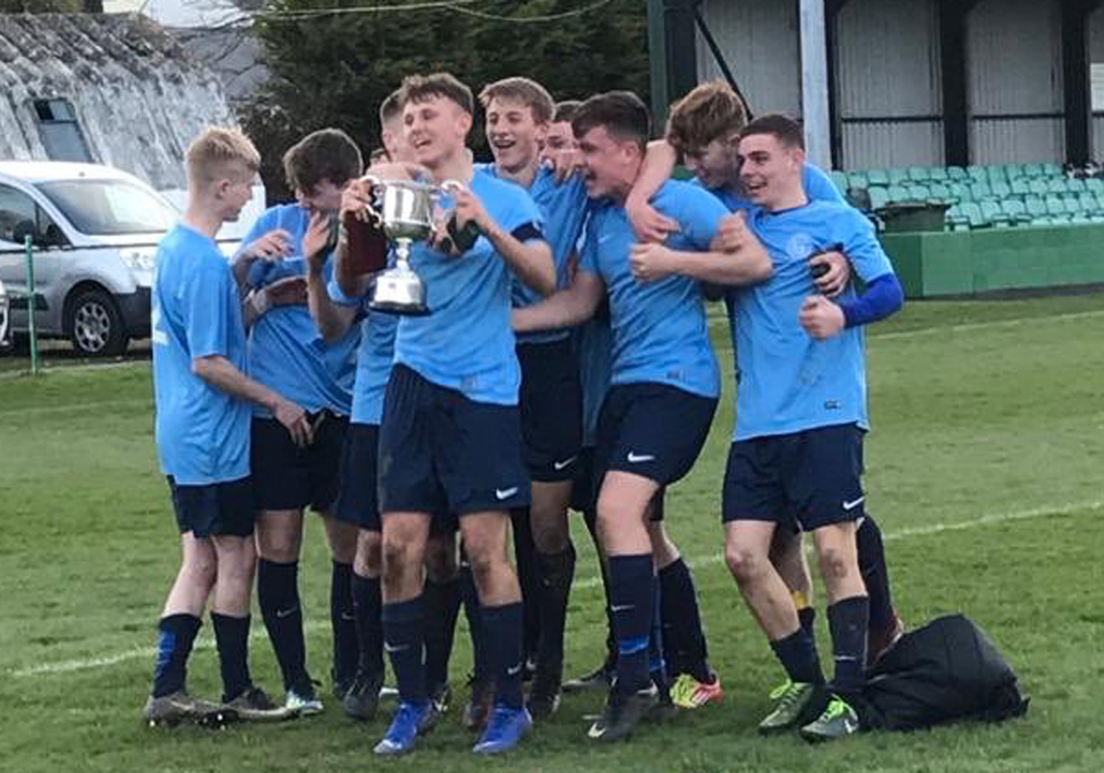 Berks & Bucks under 18s celebrate the South & West County Championship title.