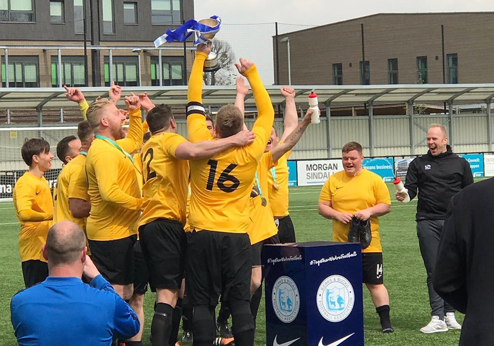 Bearwood Wanderers lift the cup. Photo: Tony Hardy.