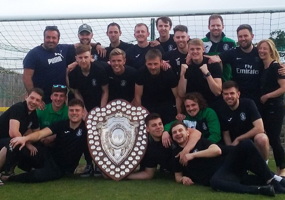 Wantage Town with the Hellenic League shield. Photo: Wantage Town FC