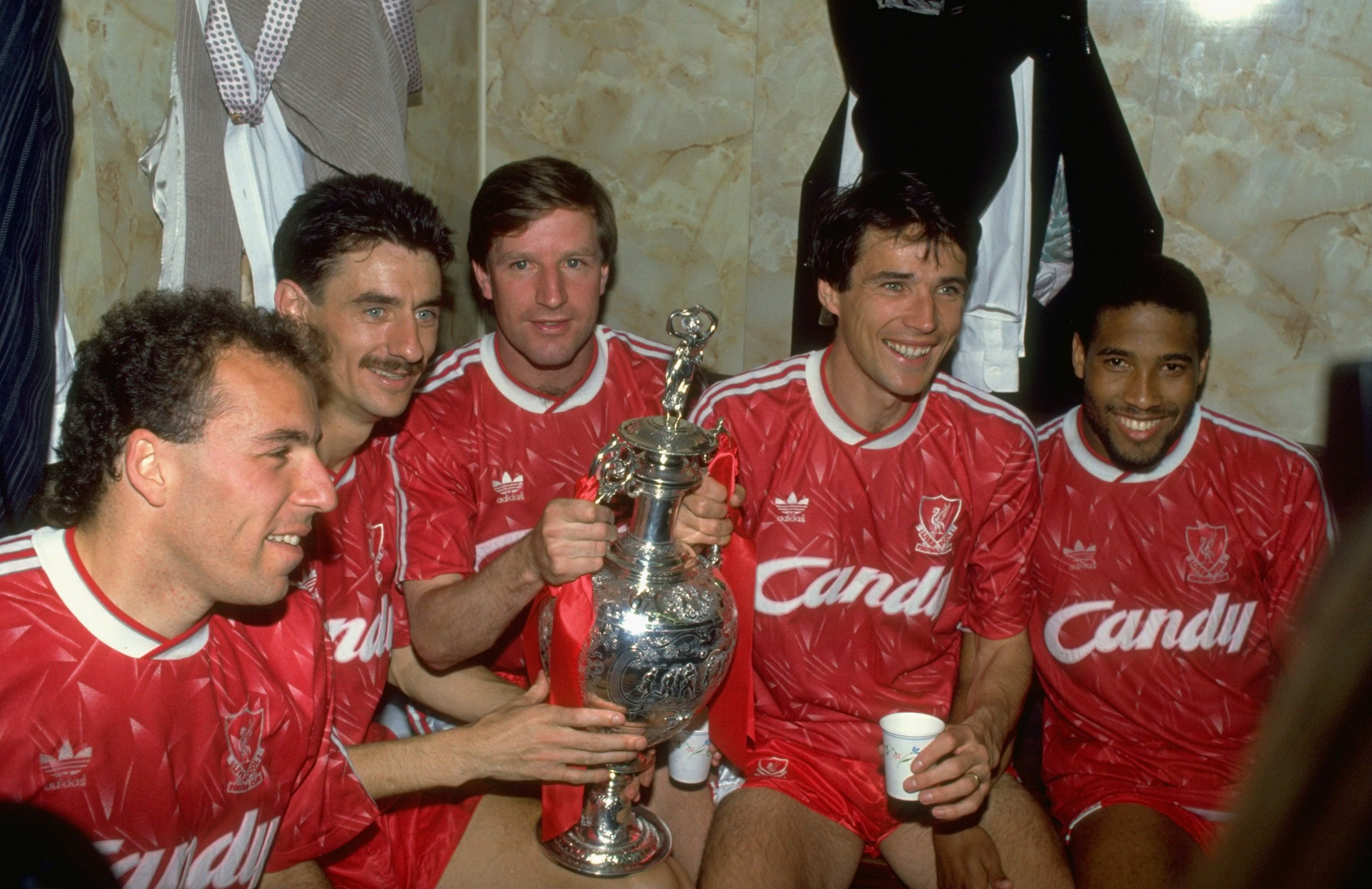 1 May 1990: (L-R) Ronnie Rosenthal, Ian Rush, Ronnie Whelan, Alan Hansen and John Barnes of Liverpool celebrate after the Barclays League Division One match against Derby County at Anfield in Liverpool, England. Liverpool won the match 1-0 and became league champions. Mandatory Credit: Dan Smith /Allsport