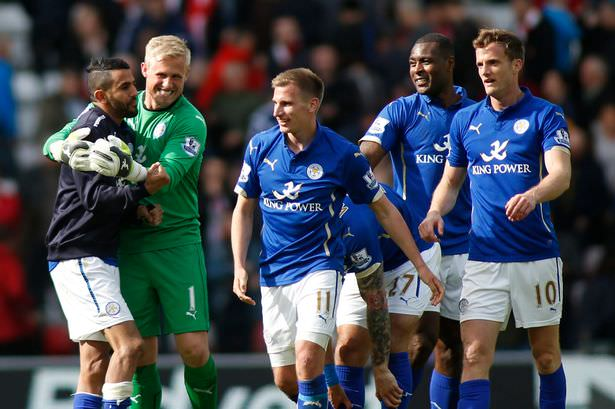 Leicester City players rejoice after securing survival in the top division with a draw against Sunderland in the last game of their 2015/16 season