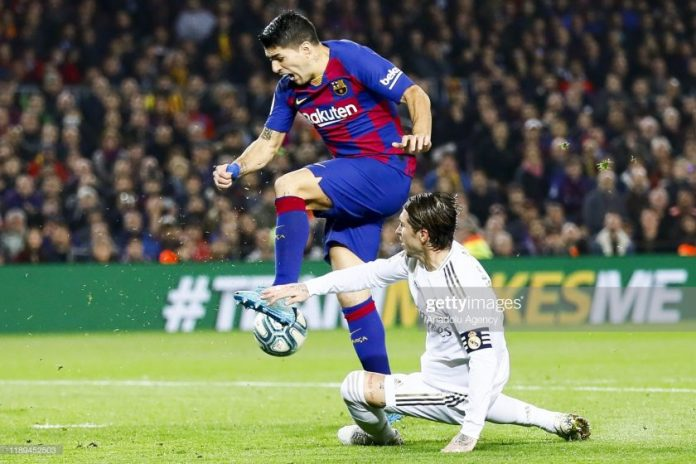 Luis Suarez (L) and Sergio Ramos (R)