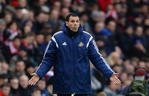 Manager Gustavo Poyet of Sunderland looks on