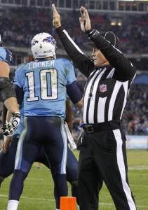 Side judge Rick Patterson signals touchdown on a run by Titans quarterback Jake Locker during Monday's lackluster game with the Jets. When a game lacks excitement, officials must keep their focus and concentration at 100%.