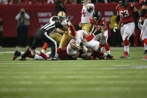 Umpire Carl Paganelli is about to separate a pile after a fumble recovery by the 49ers. (San Francisco 49ers photo)