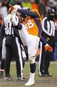 The officials were dressed for the frigid conditions (Denver Broncos photo)